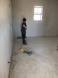 caden cleaning floors